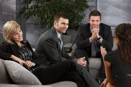 Corporate businesspeople having break, resting on sofa, talking. Stock Photo - 6711860