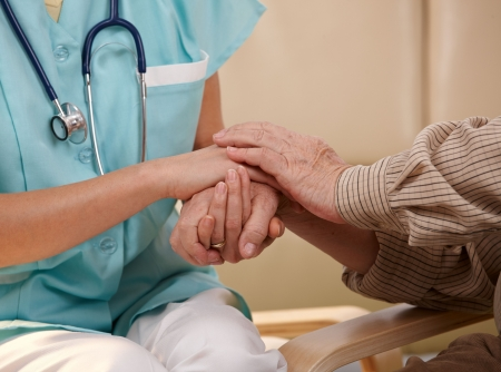 nurse patient: Closeup of joined hands of nurse and elderly patient.