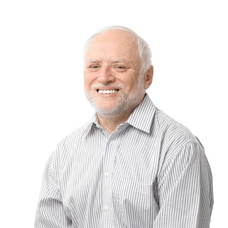 boomers: Portrait of happy senior man looking at camera, smiling. Isolated on white background. Stock Photo