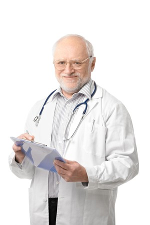 Portrait of happy senior doctor looking at camera, holding clipboard, smiling. Isolated on white background. photo