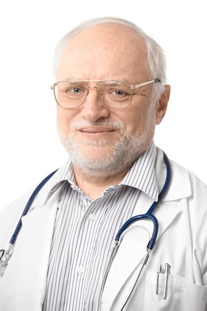 Portrait of happy senior doctor looking at camera, smiling. Isolated on white background. photo