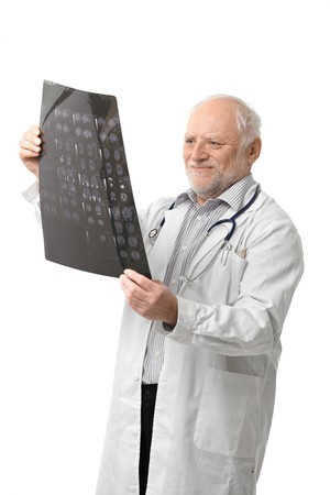 Portrait of happy senior doctor looking at X-ray image, smiling. Isolated on white background. Stock Photo - 6941520