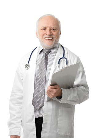 Portrait of happy senior doctor laughing, isolated on white. photo