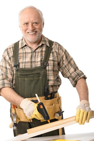 Happy senior man working with tools, cutout.   Stock Photo