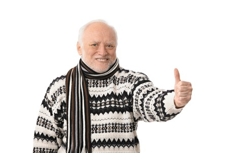 adult only: Portrait of happy senior man looking at camera, showing thumb up, laughing, isolated on white. Stock Photo