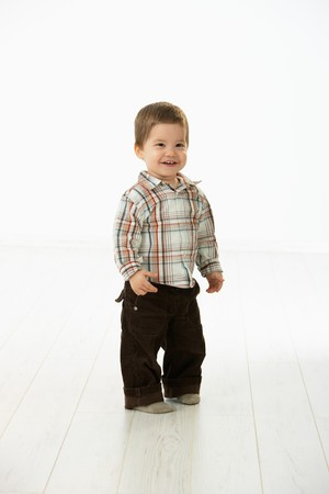 1 2 years: Full size portrait of cute little boy (2-3 years) in casual clothes looking at camera, smiling. Studio shot over white background.