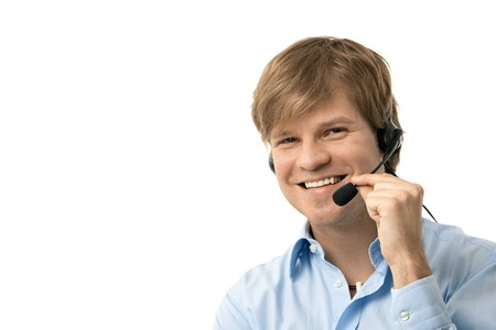 Portrait of happy young man talking on headset, smiling. Isolated on white.   photo