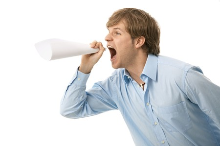 rolled up: Young man shouting through rolled up paper, as if imitating megaphone.