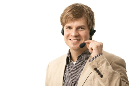 Portrait of happy young man talking on headset, holding microphone. Isolated on white. photo