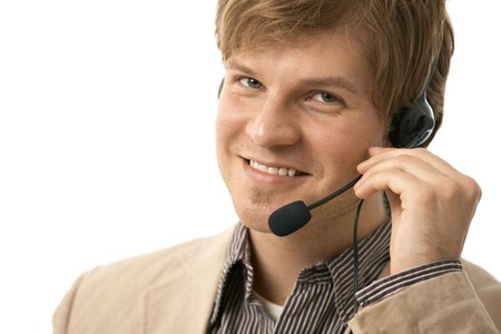 Closeup portrait of happy young man talking on headset, holding microphone. Isolated on white. photo