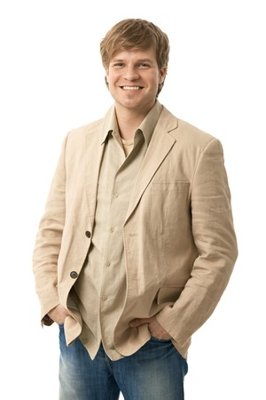 one young man only: Portrait of casual young man, standing with hands in pocket, smiling. Isolated on white. Stock Photo