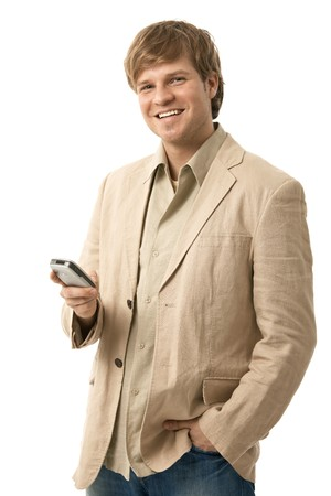 Happy young man using mobile phone, looking at camera, smiling. Isolated  on white. Stock Photo - 6927323