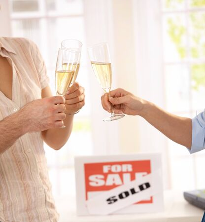 real estate sold: Celebrating purchase of new house with champagne.