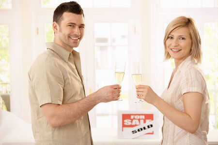 Happy couple celebrating new house purchase with champagne. Stock Photo - 7015765