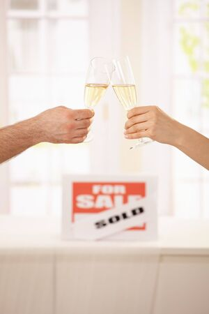 Couple celebrating new house with champagne. photo
