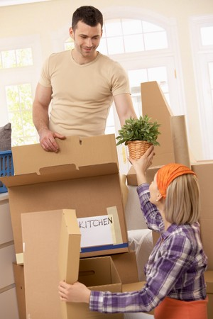 Young couple packing their property ready to move. photo