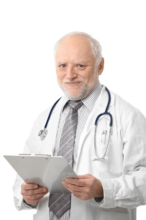 Portrait of senior doctor holding papers, smiling, isolated on white.   photo