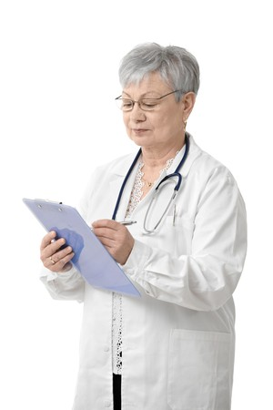 Senior female doctor writing on clipboard, isolated on white. photo
