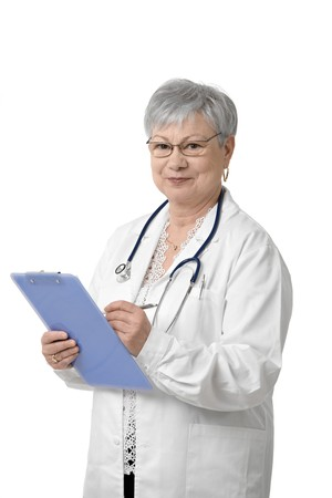 Portrait of senior doctor with clipboard looking at camera, smiling, isolated on white. photo