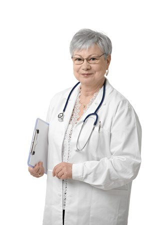 Senior physician with stethoscope looking at camera, smiling, white background. photo
