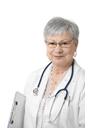 general practitioner: Portrait of senior general practitioner looking at camera, smiling, isolated on white.
