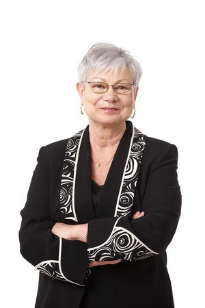 Portrait of active senior woman smiling, isolated on white. photo