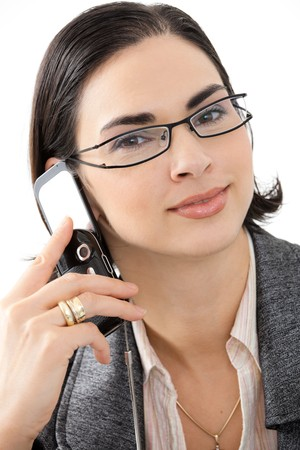 Closeup portrait of attractive young businesswoman talking on mobile phone, smiling. photo