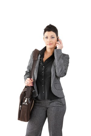 Portrait of happy young businesswoman calling on mobile phone. photo