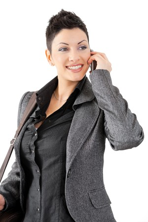 Portrait of happy young businesswoman calling on mobile phone, smiling. photo