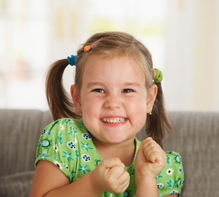 Portrait of excited little girl (3-4 years) at home. Stock Photo - 7058766