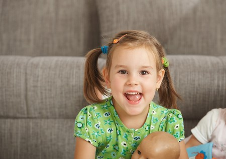 Portrait of excited little girl (3-4 years) at home, looking at camera, smiling. Stock Photo - 7058821