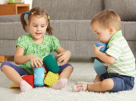 3-4 years old children playing together on the floor at home Stock Photo - 7058824