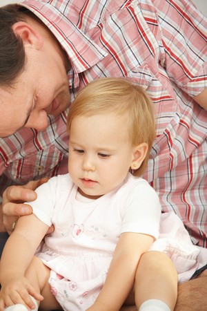 Affectionate father caressing cute baby girl. Stock Photo - 7058899