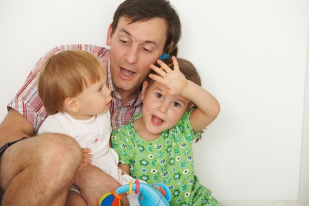 Portrait of happy father with two daughters having fun. Stock Photo - 7058820