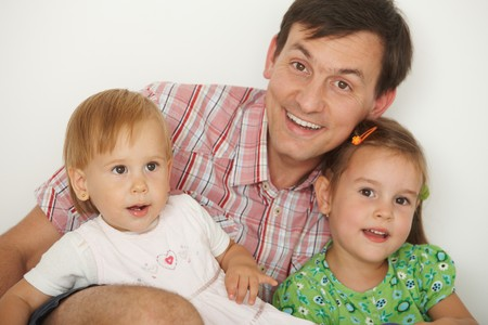 Portrait of happy father with two daughters having fun, looking at camera, smiling. Stock Photo - 7058818