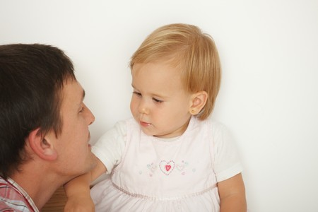 Affectionate father caressing cute baby girl, white background. Copy space on right. Stock Photo - 7058769