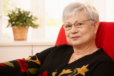 Portrait of nice white hair senior woman wearing glasses. photo