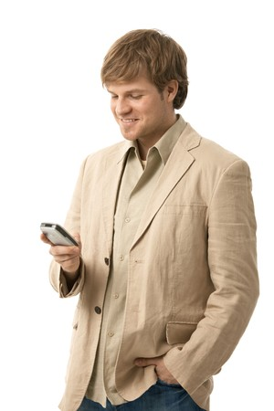 handy: Young man writing text message on smart phone, looking at screen, smiling. Isolated  on white.