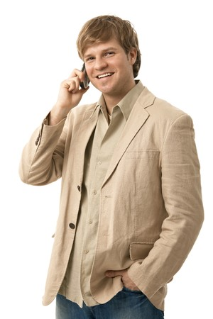 Portrait of casual young man talking on mobile phone, smiling. Isolated on white.