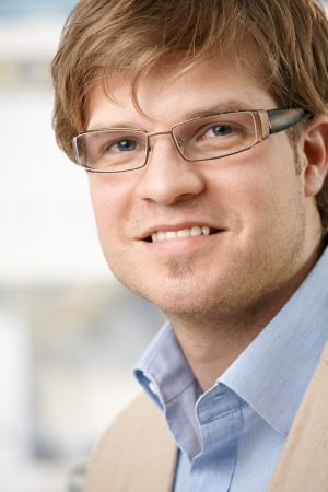 Closeup portrait of casual young businessman with glasses, smiling. Stock Photo - 7130170