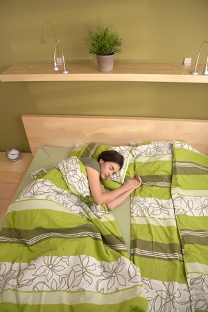 nighty: Woman sleeping alone in morning in bedroom. Stock Photo