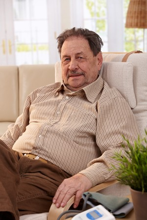 Portrait of senior man resting in armchair, looking at camera. Stock Photo - 7249308