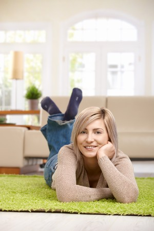 Attractive blond woman relaxing at home.   photo