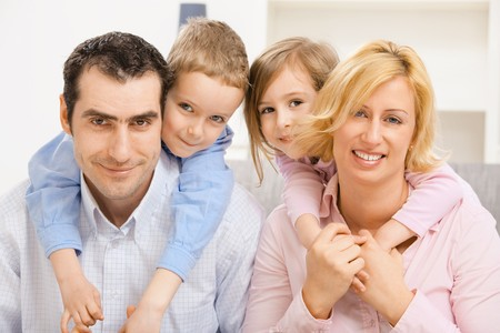 Portrait of happy family, children hugging their parents. Stock Photo - 7273211