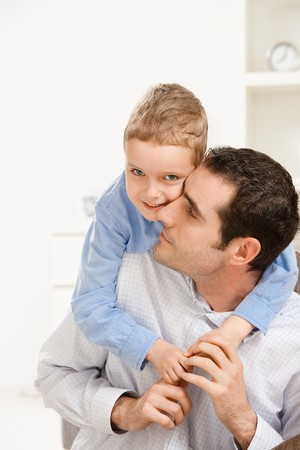 piggyback: Father giving his son piggiback ride, smiling. Stock Photo