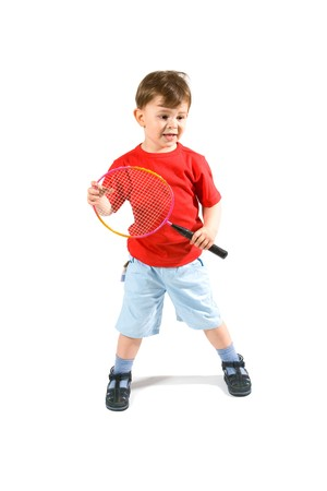 3 years old boy playing badminton, isolated on white. photo