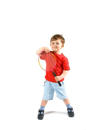 3 years old boy playing badminton, isolated on white. Stock Photo - 7283810