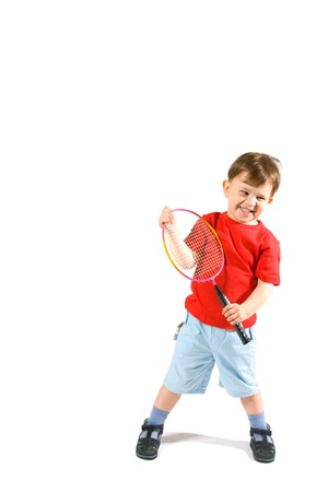 3 4 length: 3 years old boy playing badminton, isolated on white.