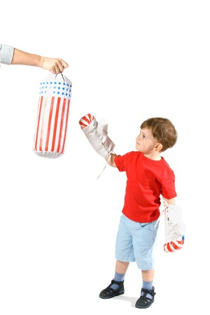 3 4 length: 3 years old boy playing box, punching bag with boxing gloves, isolated on white.
