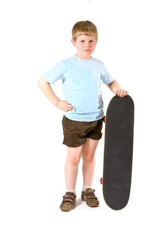 Studio shot of little boy with skateboard.  Isolated on white background. Stock Photo - 7284078